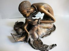 Bronze statue from Africa of a mother and child.