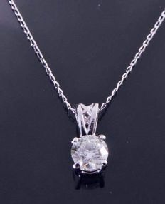 18 kt white gold solitaire pendant with one brilliant cut diamond of 0.30 ct, with necklace of 46 cm ***No Reserve Price***