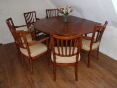 A both square and a round table with six chairs, English style, late 20th century
