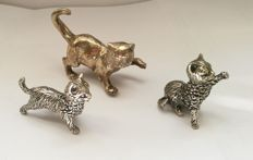 Lot of three silver cats