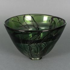 Willem Heesen - Unica: Thick-walled green glass bowl with black threads of glass and a carved plant motif, (signed)