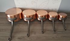 Series of five copper tinned pots