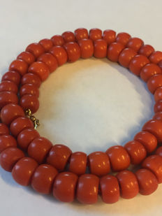 Antique, red coral necklace with 14 karat gold clasp and very large red coral.