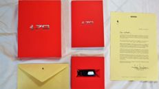 Ferrari - box set celebrating the 70th anniversary of Ferrari, Limited Edition, Leather Keyring, Commemorative Booklet of Annual Achievements from 1947 to 2017, Letter from the President, Autographed, 2017