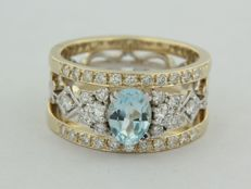14 kt bicolour gold ring set with 0,85 ct topaz and 34 brilliant cut diamonds 0.61 ct, ring size 17,5 (55)
