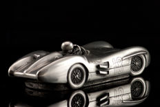 Silver tin model of the Mercedes Benz with Juan Manual Fangio