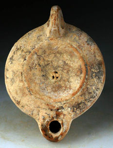 "Roman discus shaped pottery oil lamp - 115 mm(4,6"") long and 83 mm (3,8"") at the widest section"