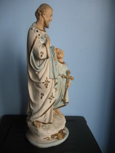 Antique French Saint Joseph and Jesus sculpture.