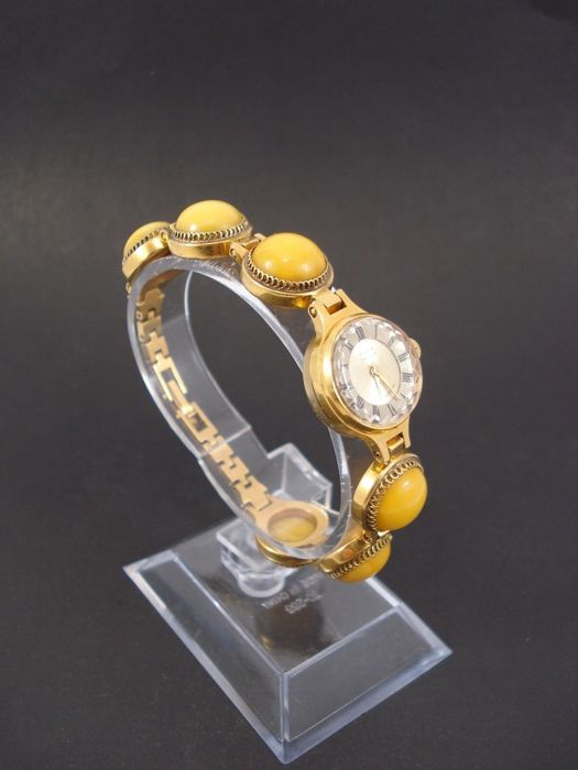 Vintage CAHJKA Russian women's bracelet-watch made of natural amber, ca. 1950-1955