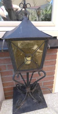 Wrought iron patio lantern on a base, France, 1960-1970