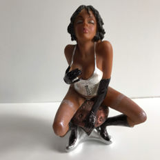 Decorative; statue of pin-up on stool - 21st century