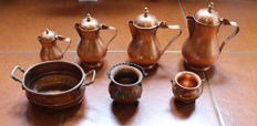 Set of jugs and jars in copper