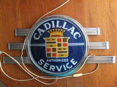"An original vintage metal with glass ""Cadillac"" sign ""authorized service"" with inside lighting, USA fifties/sixties"