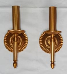 A pair of brass wall candlesticks in Empire style