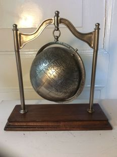 Nice decorative globe of metal on wooden stand, 21st century