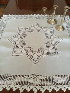 Tea tablecloth with crochet inserts.