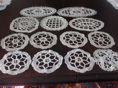 Lot of thirteen Bruges bobbin laced doilies.