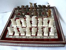 Bone chess. Wooden and nacre case.