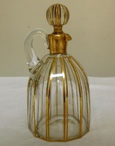 "Baccarat crystal liquor decanter, model ""Cannelures"", enhanced  with gilded bands, early 20th"