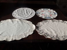 Lot of tablecloths including one with ribbon trim and three embroidered tablecloth.