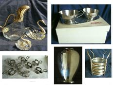 Collection silver plated table decorations - decanter with duck head, sauce pots with swan head, coasters, vase, cream set in original box and 8 napkin rings in the shape of a swan.