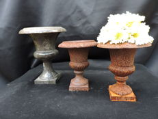 lot of 3 small garden ornaments including marble and cast iron, one with arrangement.