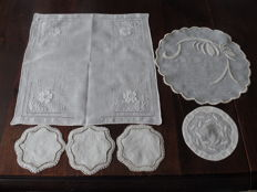 Two handmade doilies of Italian embroidery.