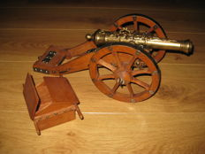 Bronze cannon on wooden gun carriage