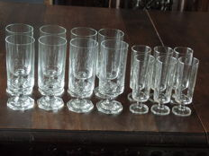 Lot of 14 crystal long drink glasses on foot.