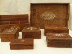 Five wooden boxes, a letter holder and a tray, cut-out and with bone inlay
