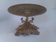 Richly finished copper fruit bowl with fishes and the bowl decorated with flowers and faces
