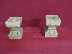 Pair of carved stone capitals