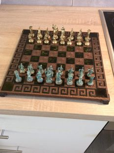 Chess with pieces in iron