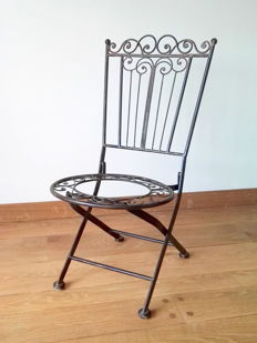 A vintage wrought-iron chair