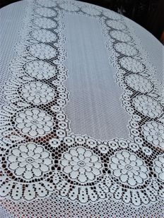 large white tablecloth or bed spread