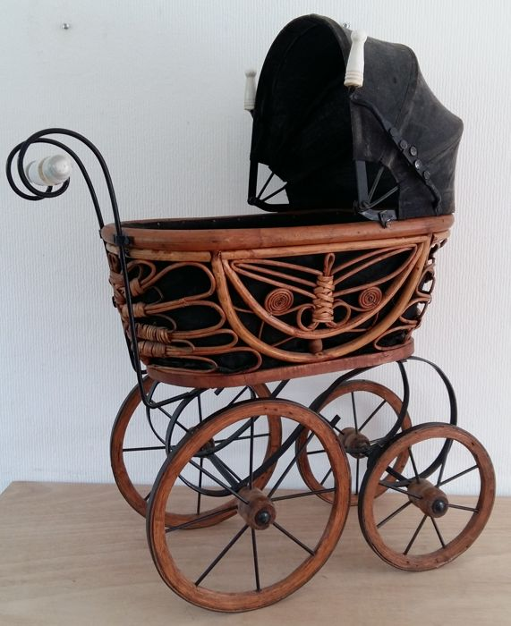 Nostalgic doll's pram of iron, rattan and wood