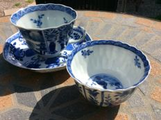 Two blue and white cups and a saucer - China - 18th and 19th century