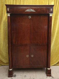 An Empire mahogany secretaire à abattant, with bronze frames, first half 19th century