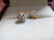 18 kt gold earrings set with zirconias