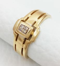 Ring in 18 kt/750 white and yellow gold with diamonds Weight: 4.14 g.