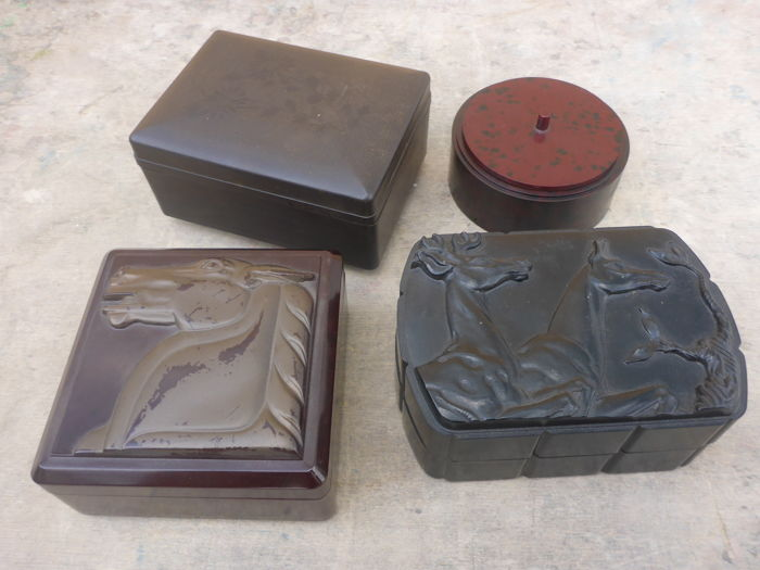 Four bakelite boxes