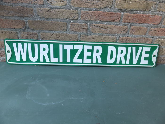 "A rare enamel sign with the text ""WURLITZER DRIVE"" in 2D, probably from the USA, 20th century."