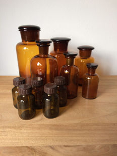 Lot of 11 brown glass apothecary jars