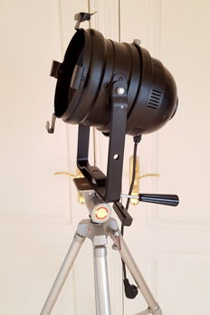 Industrial theatre spotlight on vintage tripod