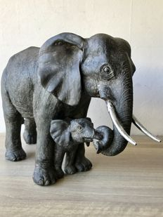 Very large handmade sculpture of an elephant with calf