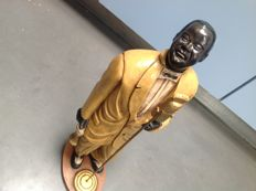 Wood and composite sculpture of Louis Armstrong