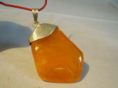 A big silver amber pendant with natural amber, made around 1930/35