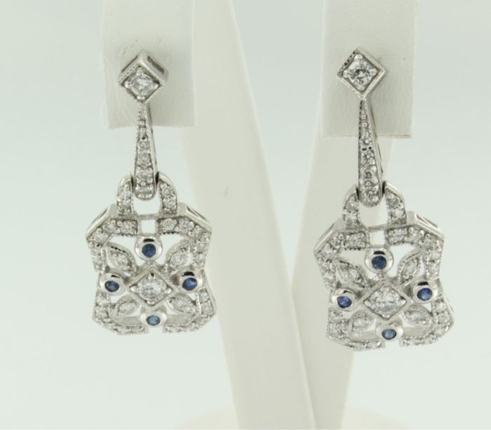 14 kt white gold dangle earrings set with brilliant cut sapphire and diamond
