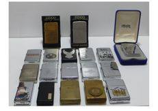 Collection of 18 ZIPPO petrol lighters of different times and models
