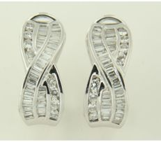 18 kt white gold clip-on earrings set with tapered shape and brilliant cut diamonds, approx. 1.50 carat in total, size 1.8 cm x 7.5 mm wide.